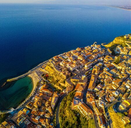 Aerial view of Pizzo Calabro, pier, castle, Calabria, tourism Italy. Panoramic view of the small town of Pizzo Calabro by the sea. Houses on the rock. On the cliff stands the Aragonese castle. Seafront
