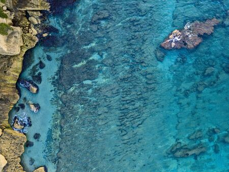 Aerial view of seabed seen from above, transparent water