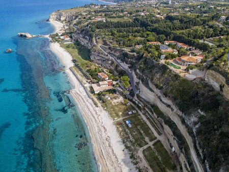 Aerial view of the Riaci promontory. Riaci beach near Tropea, Calabria. Italy. Transparent sea and wild. Cliff paths Фото со стока