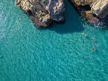 Aerial view of the Riaci rocks, Riaci beach near Tropea, Calabria. Italy. Beaches and crystal clear sea. Bathers who swim and snorkel