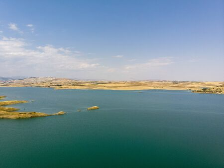 Aerial view of rural areas south of Lokman in the province of Adiyaman, Turkey. Inlets on the Euphrates river formed by the Ataturk dam. Desert lands