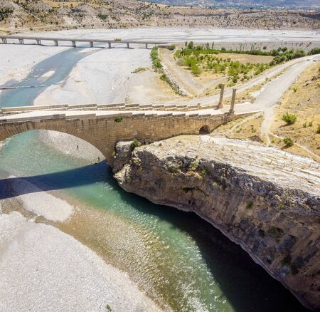Aerial view of the Severan Bridge, Cendere Koprusu is a late Roman bridge, close to Nemrut Dagi and Adiyaman, Turkey. Flanked roadway by ancient columns of Roman Emperor Lucius Septimius Severus
