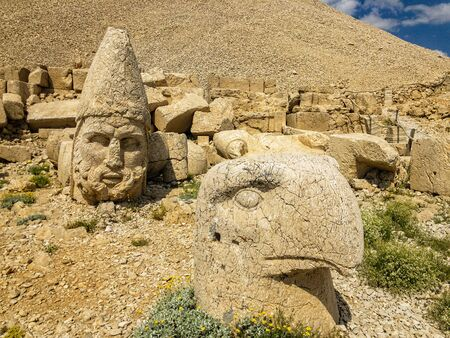 Panoramic view of the statues near the peak of Nemrut Dagi. King Antiochus I Mount of Nemrut at tomb-sanctuary flanked by huge statues. turkey