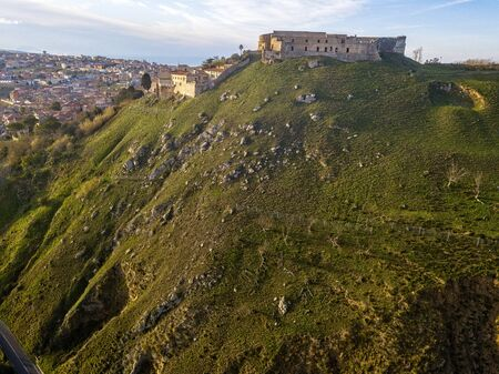 Aerial view of the Norman Swabian castle, Vibo Valentia, Calabria, Italy. Overview of the city seen from the sky, houses and rooftops