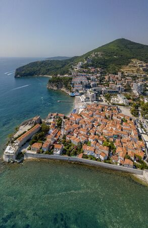 Aerial view of Budva, the old city (stari grad) of Budva, Montenegro. Jagged coast on the Adriatic Sea. Center of Montenegrin tourism, well-preserved medieval walled city, sandy beaches Stock Photo