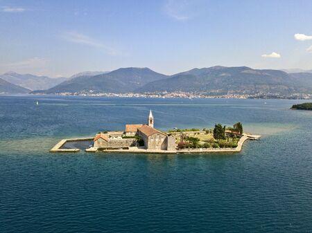 Aerial view of the island of Notre Dame de la Mis�ricorde, monastery in the Bay of Kotor near the island of Sveti Marko, Montenegro. Ostrvo Gospa od Milosrda.