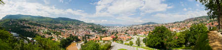 Panoramic view of Sarajevo the capital of Bosnia and Herzegovina. Houses, mountains, hills and roofs of the city seen from above