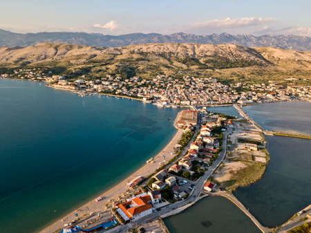 Aerial view of the town of Pag, on the island of Pag, Croatia. Seabed. Panoramic view of the city. Wild and desert nature. Headlands and cliffs of the Croatian coast. Houses on the sea at sunset