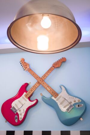 70s guitars hanging on the wall Stock fotó