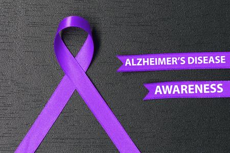 alzheimer s disease: Purple ribbon. Alzheimers disease awareness. Healthcare and medicine concept.