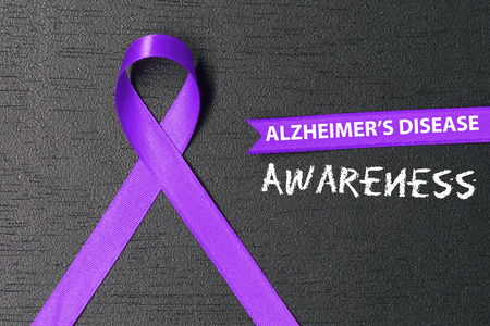 Purple ribbon. Alzheimers disease awareness. Healthcare and medicine concept.