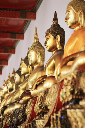 Golden Buddha statue. Wat Pho, Bangkok, Thailand Stock Photo