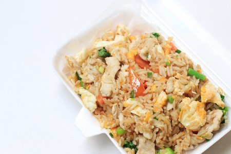 Thai Foods - Fried Rice with Vegetables and Meat in foam box Stock Photo