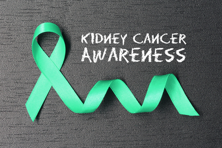tumors: Kelly green ribbon. Kidney cancer awareness. healthcare and medicine concept. Stock Photo