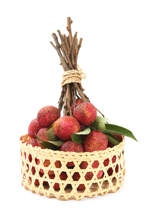 lychee in basket on white background. Stock Photo