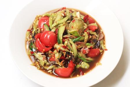Som Tum, Cucumber salad. Traditional Thai food.