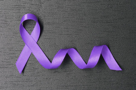 Purple ribbon. Lavender ribbon. World cancer day concept.