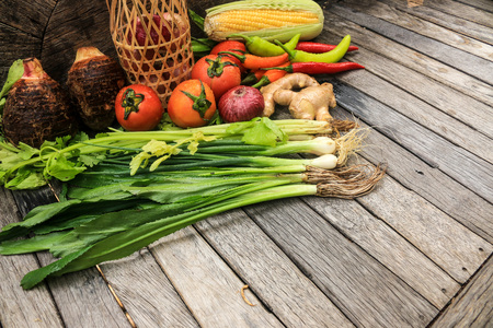 Organic vegetables on wooden table background. Healthy food background.