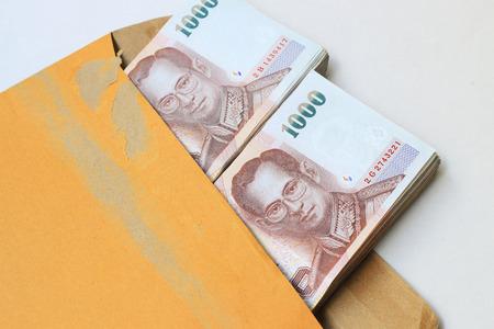 Thai money in brown envelop Stock Photo