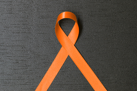 Orange ribbon. Multiple Sclerosis awareness. healthcare and medicine concept.