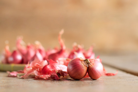 red onion on wooden table background Banco de Imagens - 110093178
