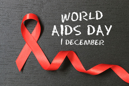 Red Ribbon. Aids Awareness. World Aids Day concept. Stock Photo