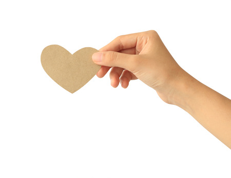 Woman hand holding paper heart isolated on white background