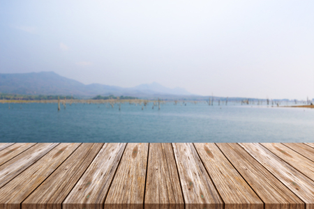 Empty top of wooden table and blurred mountain background. For display of your product 免版税图像