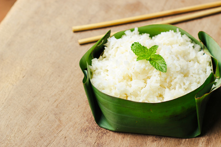 Cooked rice on banana leaf packaging