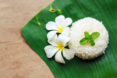 Cooked rice on banana leaf Фото со стока