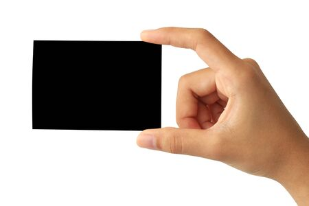 Woman hand holding blank black paper card isolated on white background