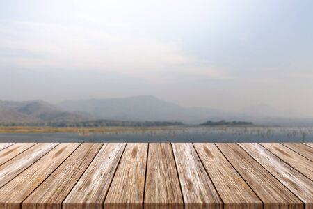 Empty top of wooden table and blurred mountain background. For display of your product Фото со стока