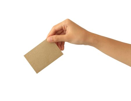 Woman hand holding blank brown paper card isolated on white background Imagens