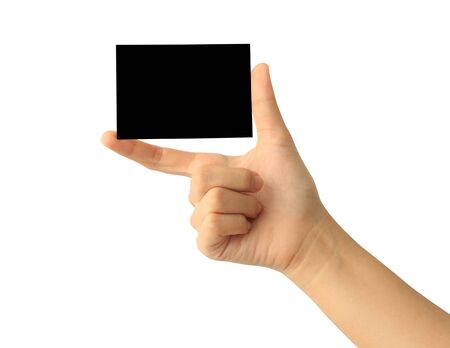Woman hand holding blank black paper card isolated on white background Banco de Imagens