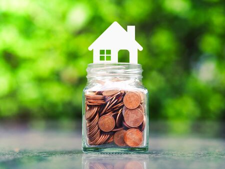 Saving money for house. Real estate or property investment concept. Stock Photo