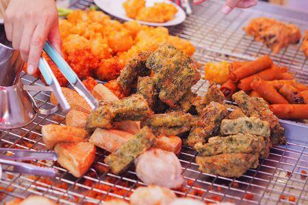 Fried Garlic Chive Dumplings, Fried tofu, Fried spring rolls and Crispy fried corn ball at market. Vegetarian food. Stock Photo - 137249603