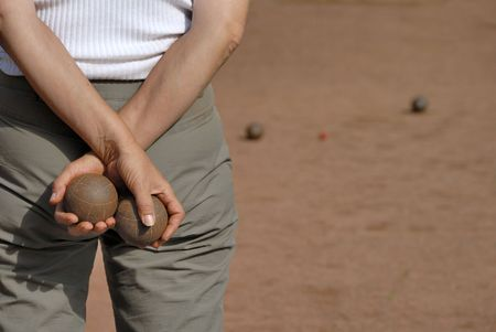 Lady playing jeu de boules in France