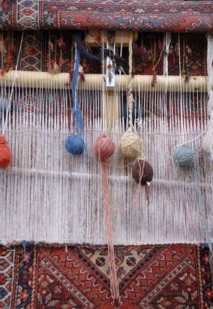 wool rugs: Weaving loom in a small village in Iran
