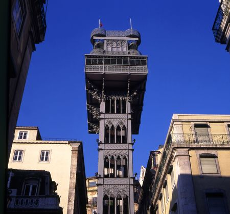Santa Justa Elevator in Lisbon, Portugal. Connecting downtown to Bairro Alto (the lowest and highest points of the city). Made by the French architect Raoul de Mesnier du Ponsard (an apprentice of Gustave Eiffel, explaining the structures similarities to