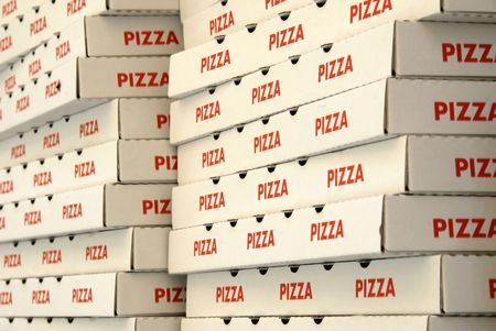 Pizza boxes in a take away pizzeria Stock Photo