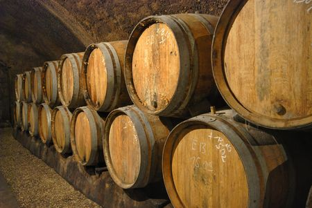 Wine cave with old fashioned wooden barrels