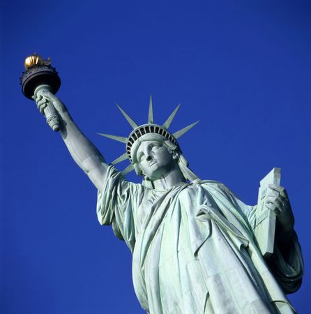 Statue of Liberty in New York USA against clear blue sky Stock Photo