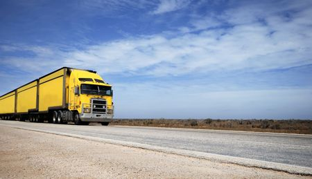 Yellow road train in the Nullarbor desert in Australia Stock fotó