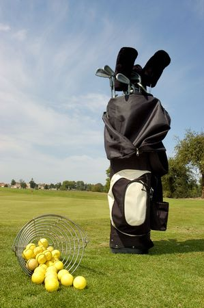 Golf bag with balls and club at the green                              photo