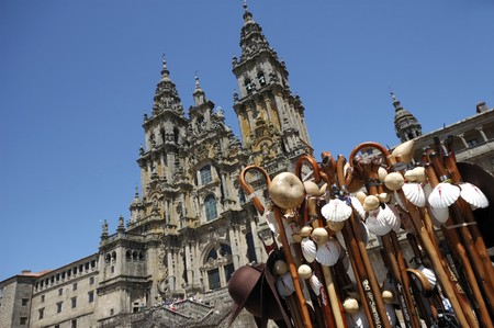 heritage site: Souvenirs in front of the Santiago of Compostela impressive cathedral.This pilgrim place is an UNESCO World Heritage site.