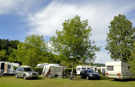 Camping in France with caravans between trees  Stock Photo