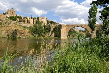 tagus: View at the old city of Toledo in Spain with bridge over the Tagus river. The city at the inner side of the wall is an UNESCO World Heritage site.