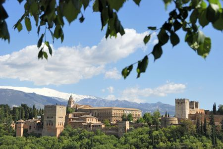 Alhambra in Granada, Spain. Seen from the old city. At the background the mountains  of the Sierra Nevada covered with snow. The Alhambra is an UNESCO World Heritage site.