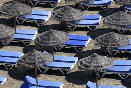 without people: Beach chairs and sun shades without people Stock Photo