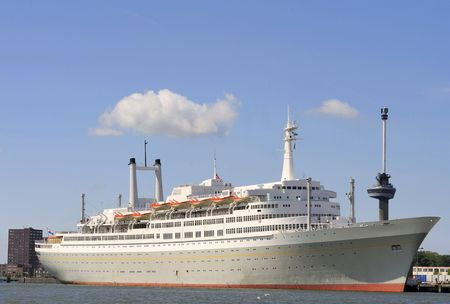 Ocean liner in the harbor of Rotterdam,Holland. At the background right, the Euromast Tower. photo